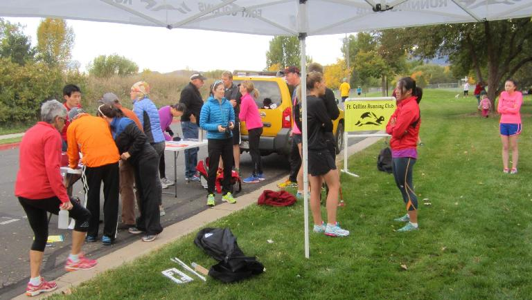 Folks mingling around the start of the Rolland Moore Park 4k.