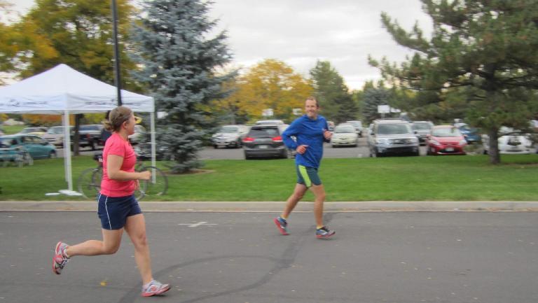 Nora beginning her run as husband Alex cheers her on.