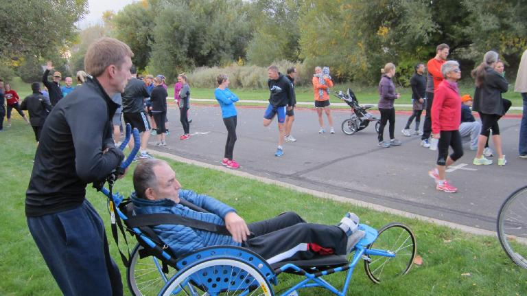 Scott pushing a guy in a stroller for Athletes in Tandem.