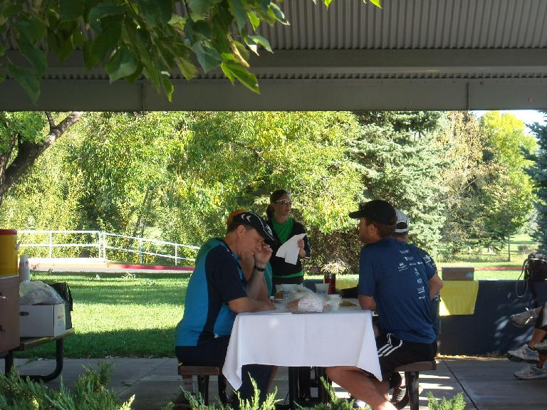 Members enjoy breakfast as Katie Q. makes some announcements for the annual Fort Collins Running Club election.
