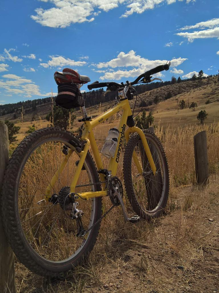 My yellow 1996 Cannondale F700 in Lory State Park with the Horsetooth Mountains in the distance.