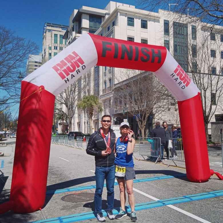 Felix Wong and Mel Sirois at the finish of the 2020 Run Hard Columbia Marathon.