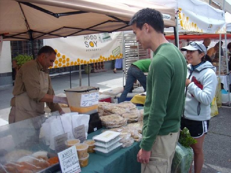 Having sweet mango lassis at the Palo Alto Farmers' Market.