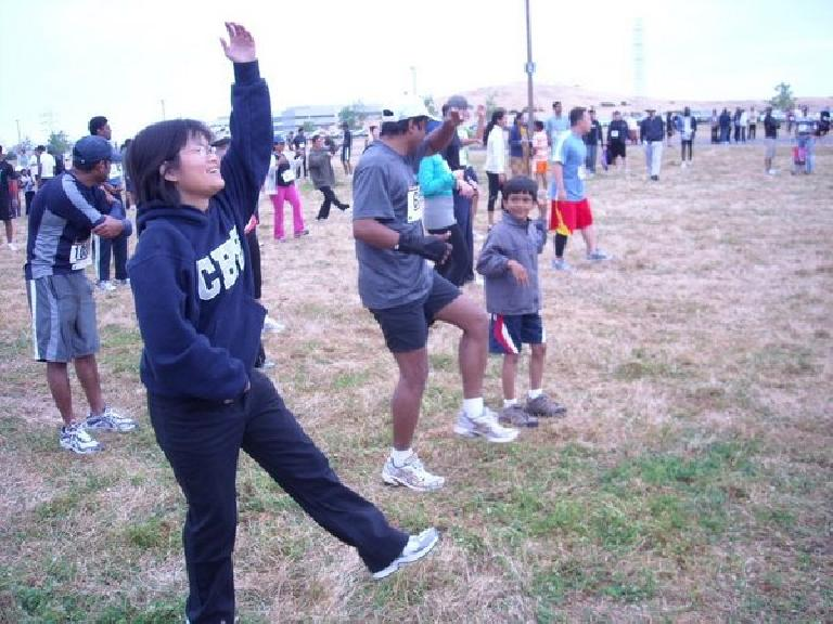 Stacey doing Indian aerobics before the race.