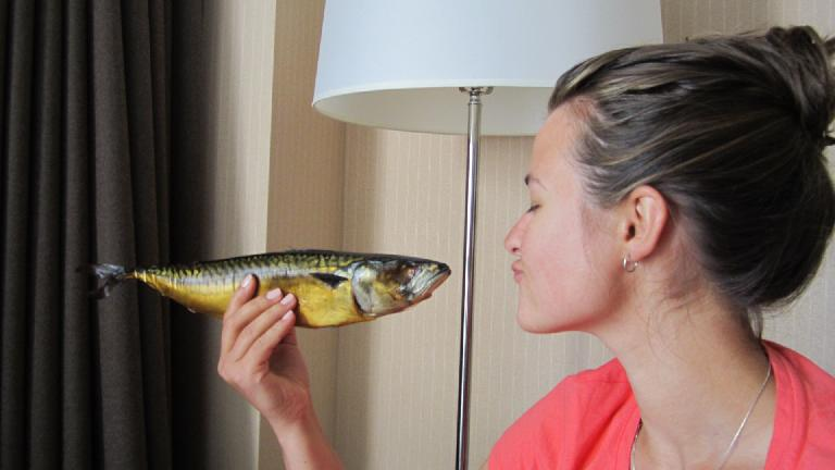 About to kiss the fried fish... or eat it?