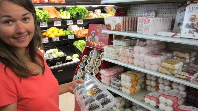 Katia with different kinds of Russian candy.