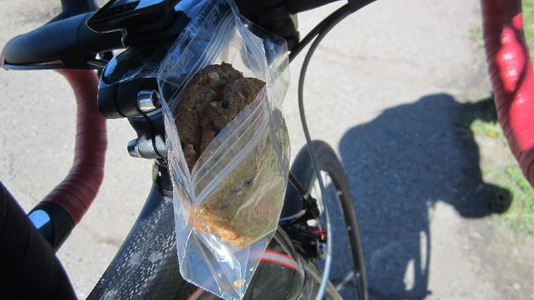 cookie, sandwich bag, taped to stem of bicycle