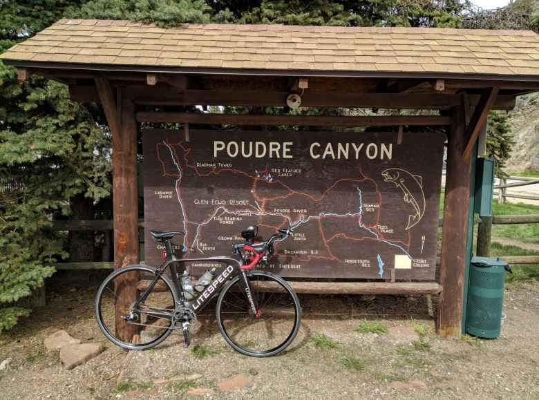 Mile 44: My Litespeed Archon C2 in front of a map of the Poudre Canyon in Rustic, Colorado.