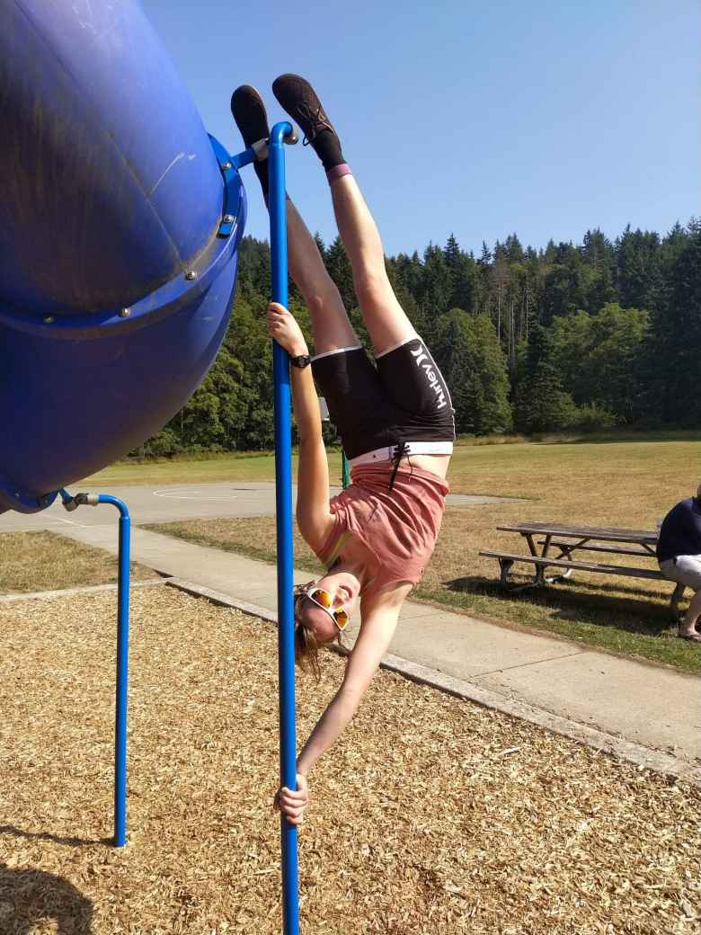 Erin being a vertical flag on playground equipment at Salt Creek County Park.