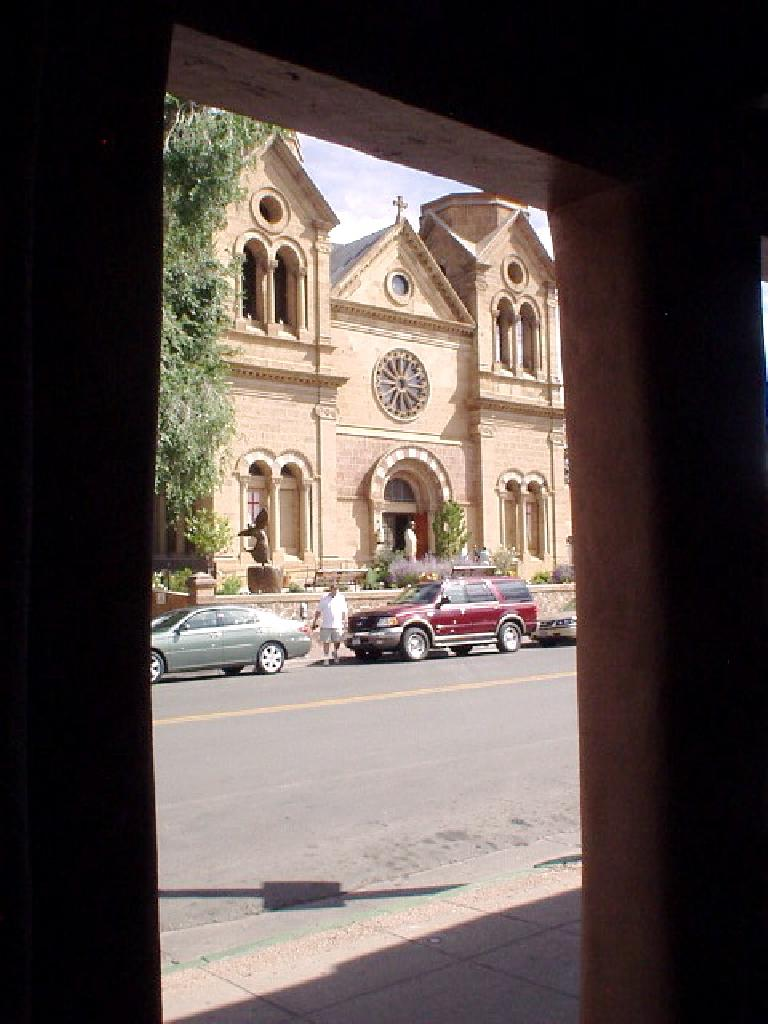 A church viewed from behind some columns.