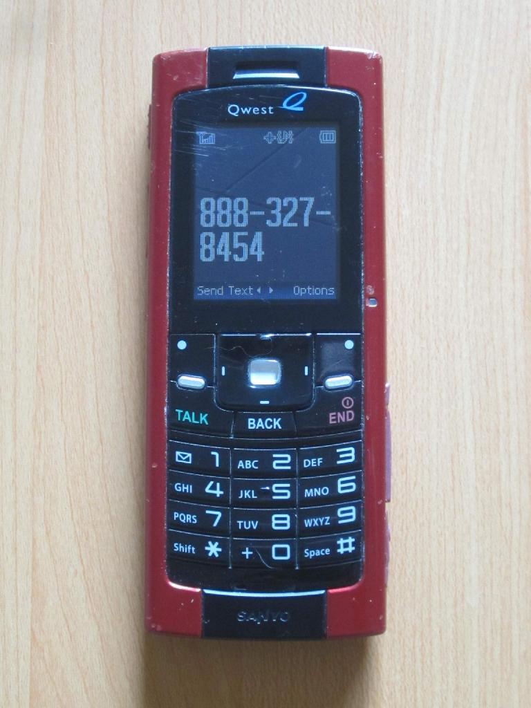 red Sanyo Qwest bar phone, 888-327-8454