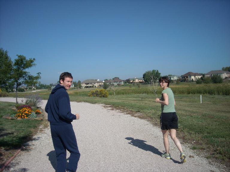 Tim and Sarah going for a run through my neighborhood.