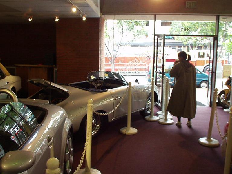"""After the quick Tijuana trip it was back to San Diego for New Year's Eve.  By chance after breakfast, we passed by VIP Classics, so we wandered in for a look.  Here's Peggy with a """"new"""" Porsche Speedster """"recreation"""" (""""not a kit!"""") going for just $23000, or about the same price as a new Miata."""