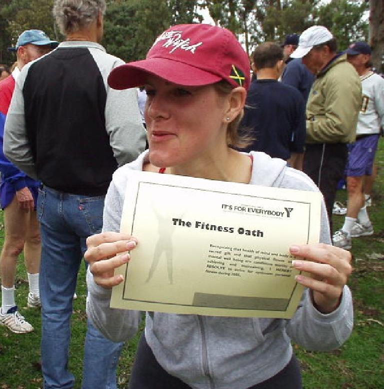 """Peggy was a lot more social than I was during the run, even finding out that Stephanie (shown here) was from my childhood town of Stockton.  Here Stephanie is holding up the """"Fitness Oath"""" we had to recite at the beginning of the run.  It was pretty funny since a """"judge"""" made us repeat the oath, but no one could remember the words since his sentences were so long!"""