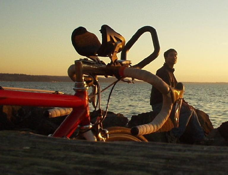 Canny looks on as Felix Wong enjoys a sunset at Saltwater State Park.