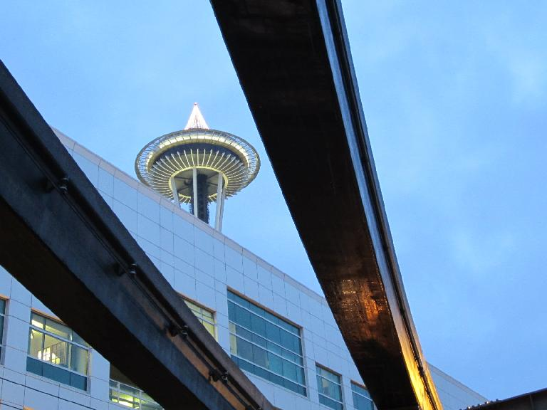 The Space Needle seen through the rails of the monorail.