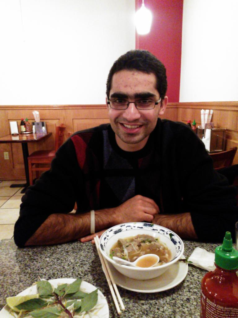 Mehdi having some pho for the first time at New Saigon Restaurant in downtown Seattle.
