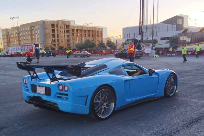 A light blue sports car with a black wing. If anyone knows what this is, please drop me a line.
