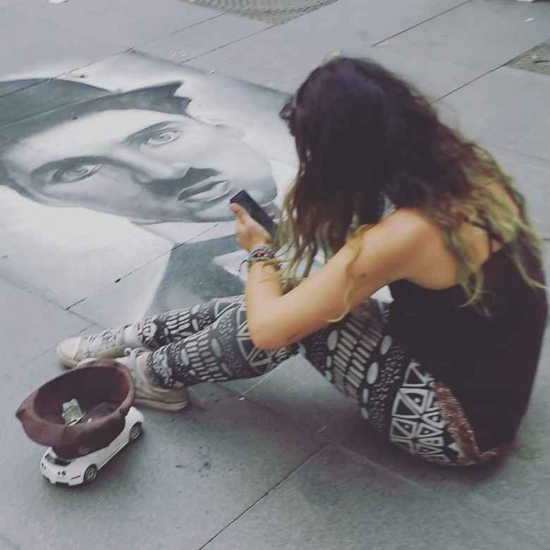 A woman doing incredible street art with chalk (I think) in Seville, Spain.