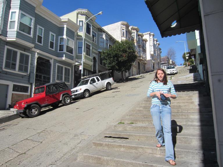 Kelly walking down Kearney Street which was so steep it had steps for pedestrians.