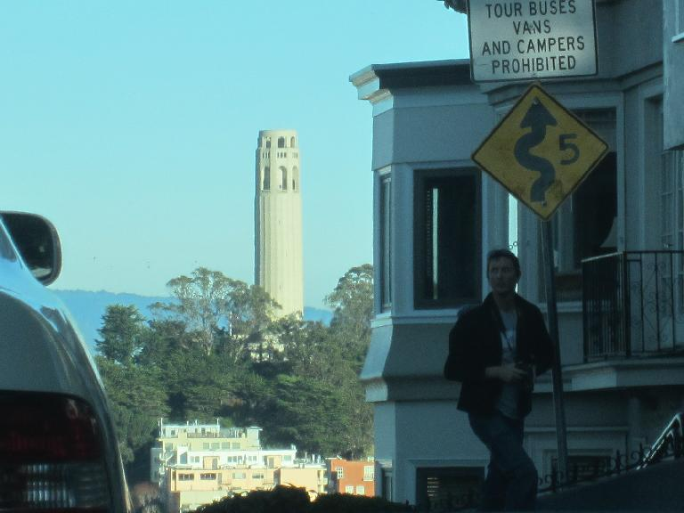 Coit Tower and a sign for the switchbacks of Lombard St.