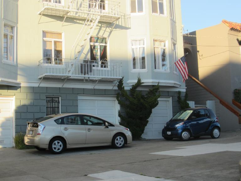 The poster cars of S.F.: a Toyota Prius and Smart car.