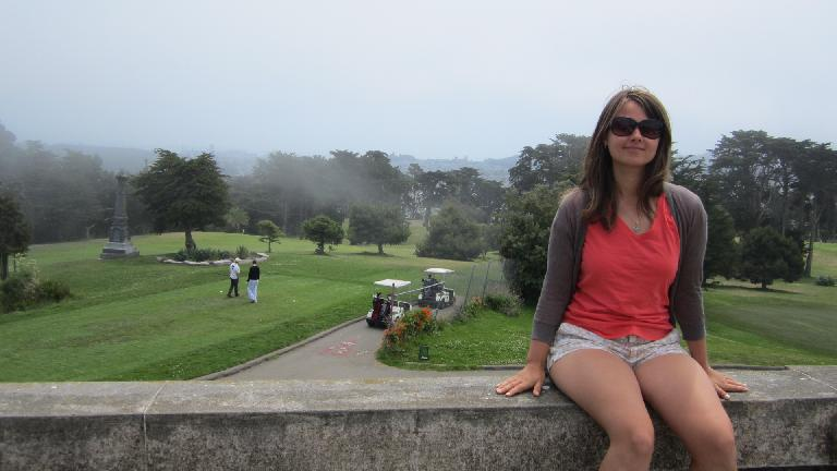 Katia in front of a golf course.