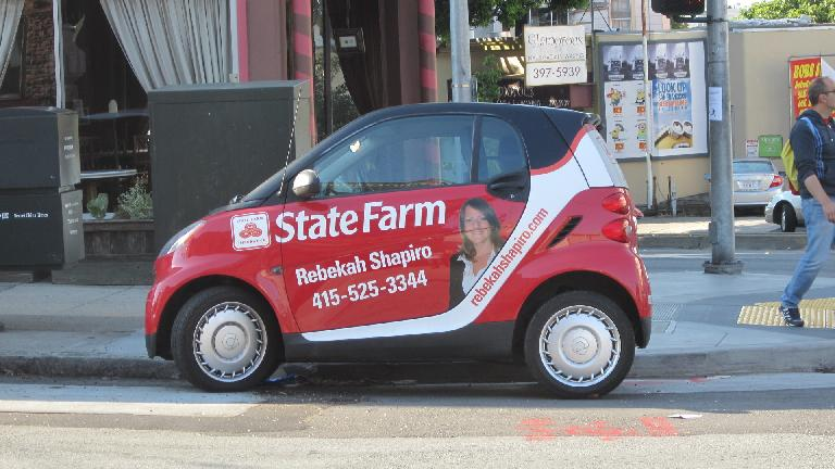 A red Smart car providing good advertising.