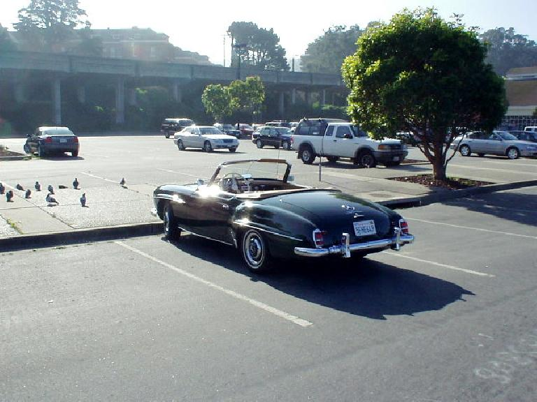 Shiny vintage Mercedes convertible.