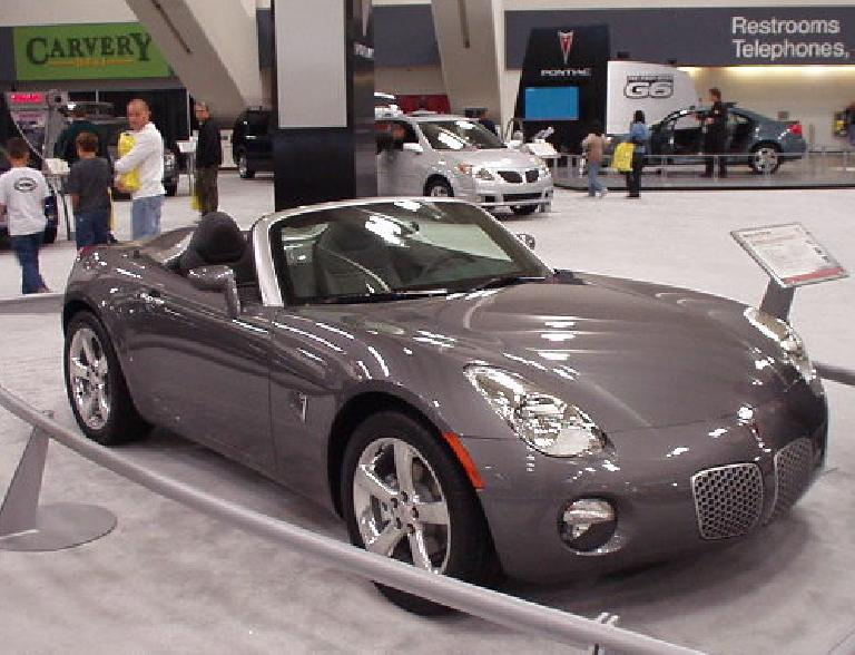 "My very favorite car at the entire auto show: the Pontiac Solstice.  This is a concept car, but will be in production next year.  Let's hope GM keeps their production ""back-to-the-basics"" sports car very similar to this one!"