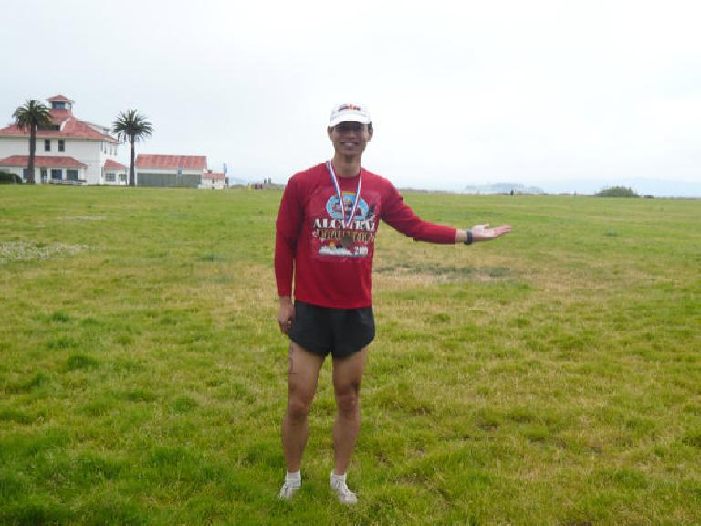 Felix Wong after the Alcatraz Challenge.  You can see Alcatraz a little bit above his hand in the distance. Photo: Alyssa Umsawasdi. (July 12, 2009)