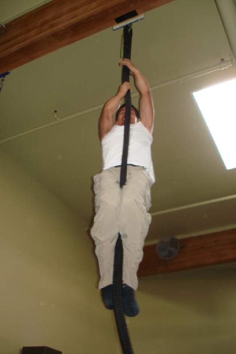 Felix Wong climbing a rope at Planet Granite