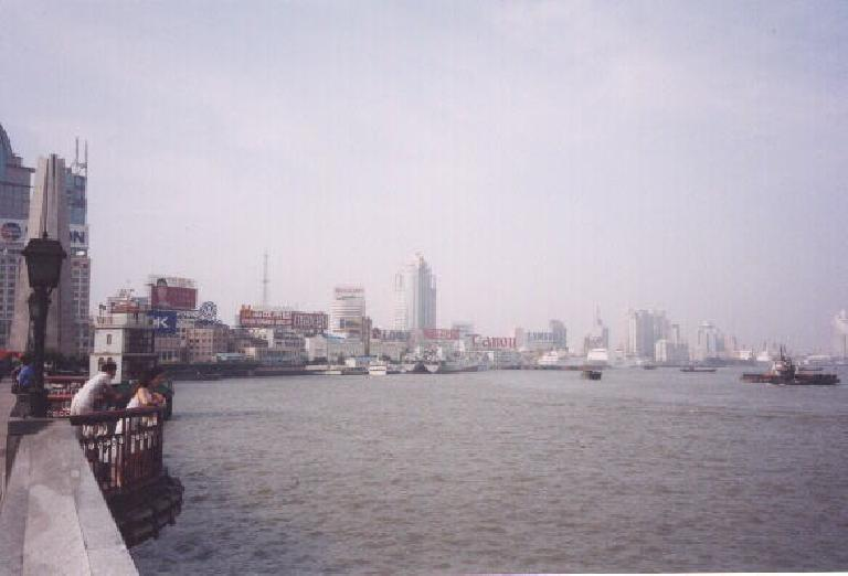 Another view at the Bund, with large corporations and their English logos.