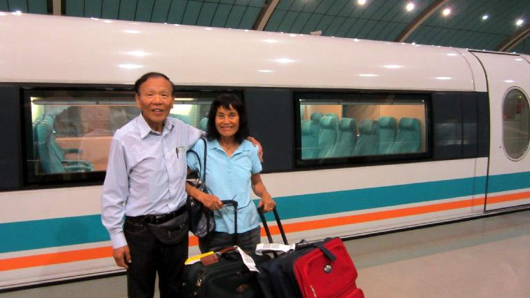 My dad and mom by the MagLev train, the fastest train in the world. It hit 300 kph while we were on it. (May 16, 2014)