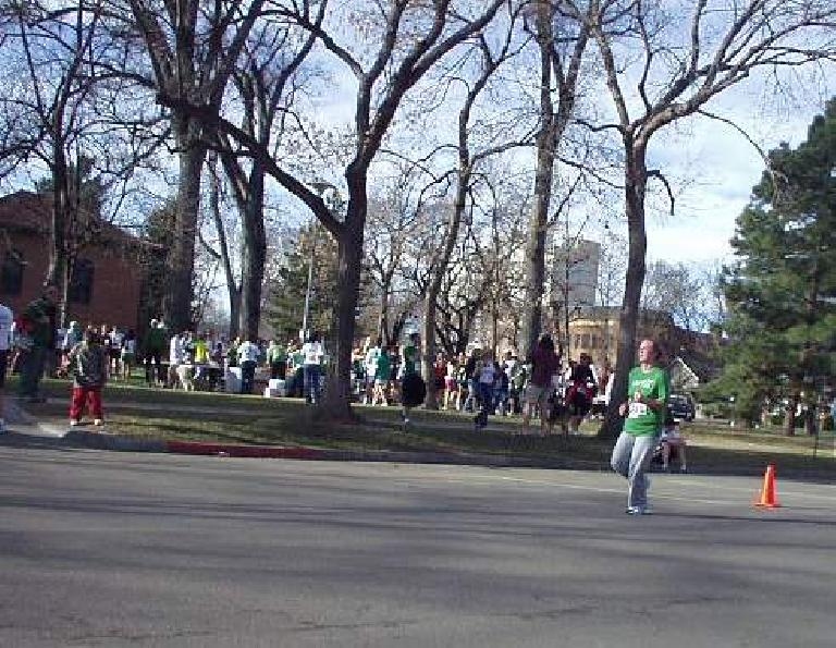 A runner in the appropriate colors approaches the finishing line.
