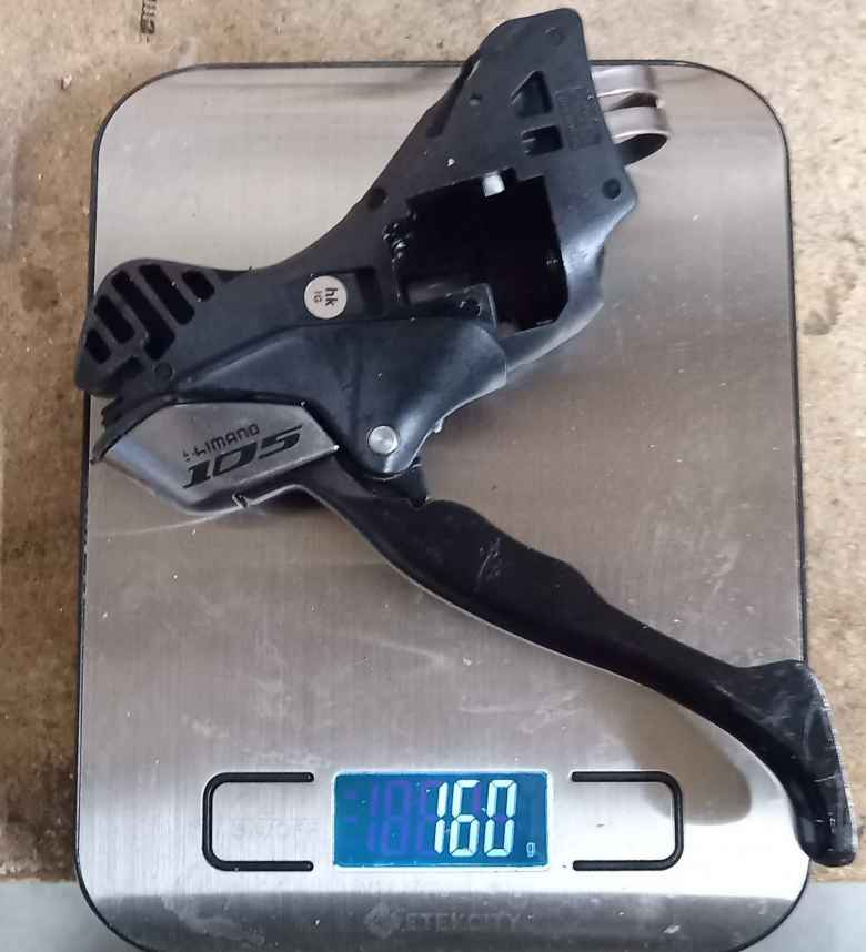 """A """"gutted"""" Shimano 105 5700 left-hand brake shift lever that had its shifting mechanism removed weighs 160 grams."""