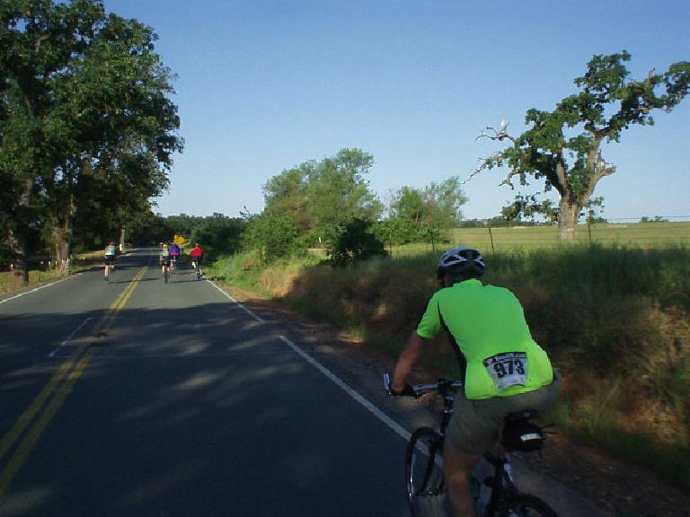 [Mile 18, 7:32am] Here's AJ cycling along during the first leg of the ride, when our overall average speed was still over 20 mph.  Belying his flat handlebars and 28mm-wide tires on his Marin cross bike, AJ proved to be amazingly strong and fast the entire ride.