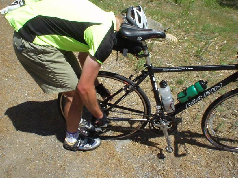 [Mile 91, 2:29 p.m.] 5 seconds after we were leaving the Mile 91 rest stop, AJ's rear tire exploded.  This was caused by a ruptured sidewall.