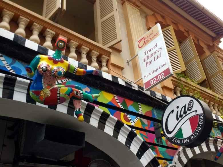 A colorful statue above Ciao Italian Risto-Bar on Haji Lane in Singapore.