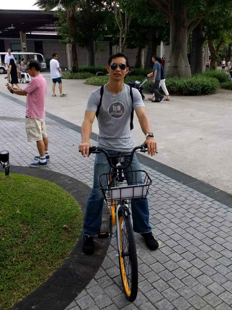 Felix Wong riding an o.bike city bike in Singapore.