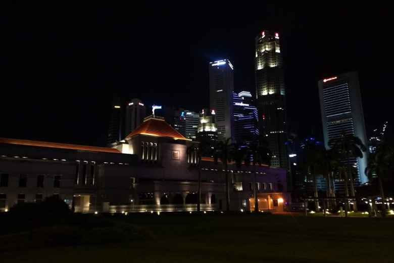 The Parliament building in Singapore at night.