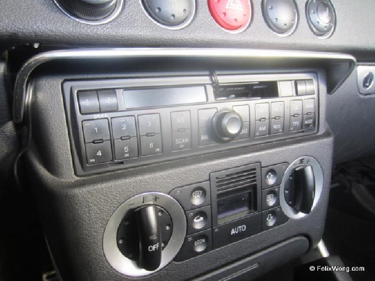 Detail of the cassette adapter installed.  The wires stay out of the way and the radio cover can still be lower and raised without hindrance.