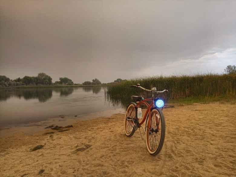 My Huffy Cranbrook cruiser bike at the neighborhood lake with dark smoke lingering above.