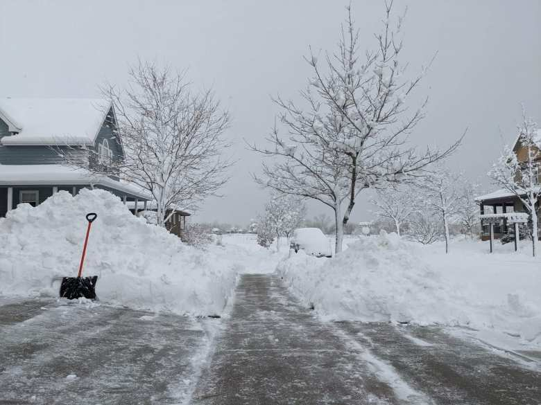 4-foot tall snowpiles next to sidewalk in north Fort Collins