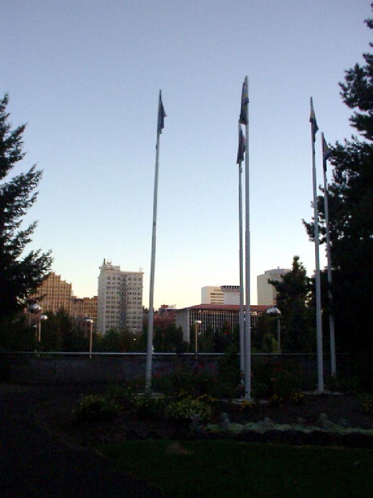 A flag display and the Spokane downtown skyline.
