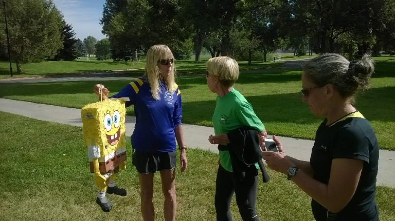 Joanne giving SpongeBob a lift while talking with Kathy and Alene.
