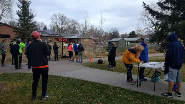 Runners and volunteers at the start of the Fort Collins Running Club's 2017 Spring Park 6k Tortoise & Hare race.