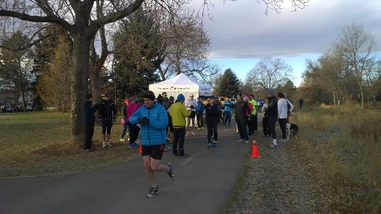 A runner taking off from the start line of the Spring Park 6k.