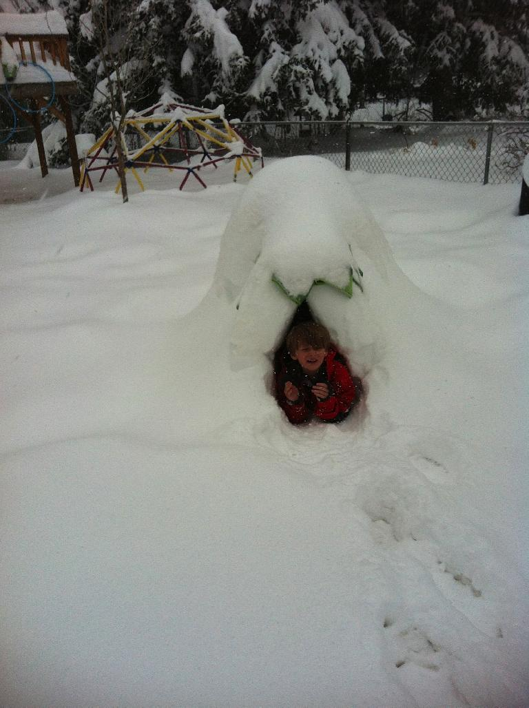 My friend Charis sent me this photo of her son in his igloo.  Apparently, he wanted to sleep in it.  Photo: Charis Ackerson. (April 17, 2013)