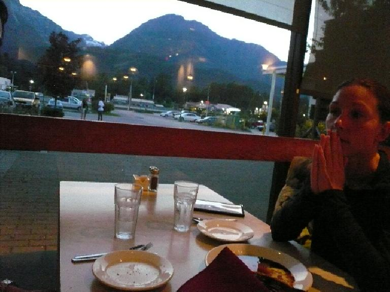 Having dinner at Giuseppe Restaurant with a view of some mountains out the window.